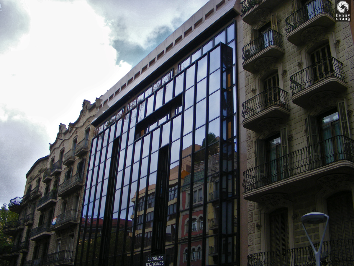 Building reflection on Carrer de Balmes