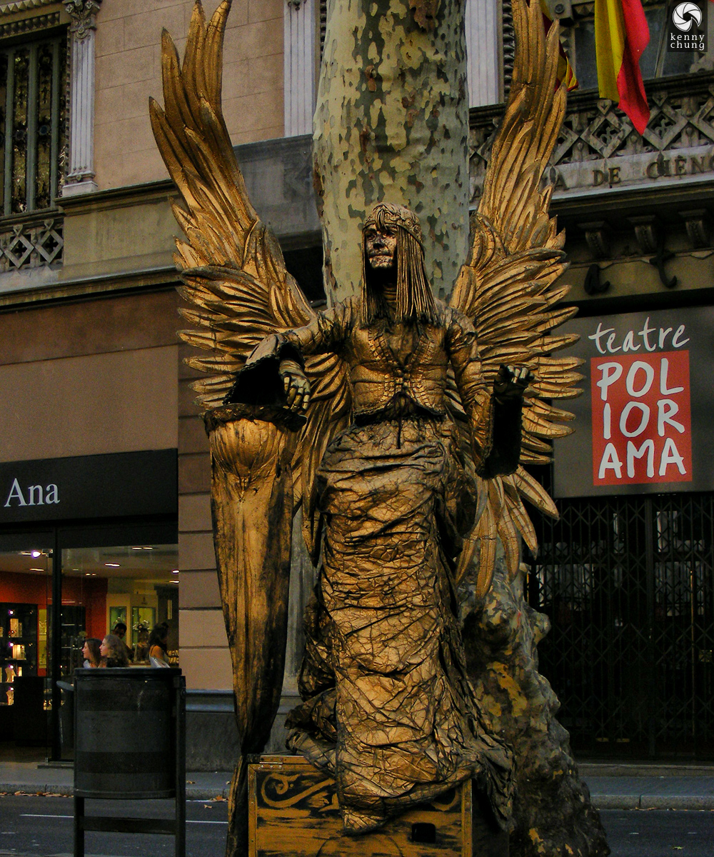 Gold Angel Street Performer Statue at La Rambla