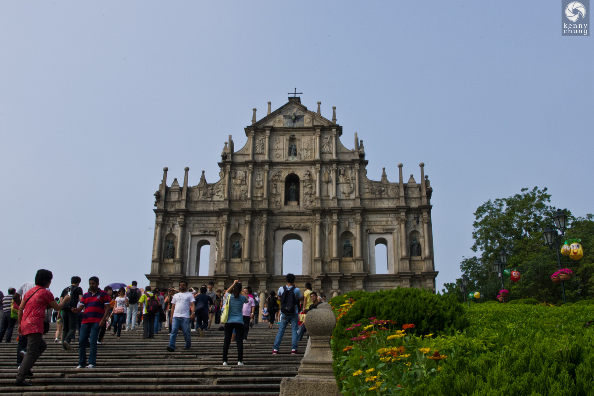 Tourists taking photos at the Ruins of St. Paul's in Macau