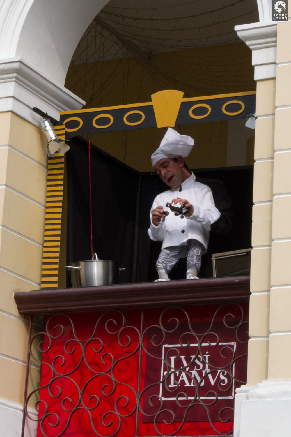 Puppeteer performing a comedy act on a balcony in Macau