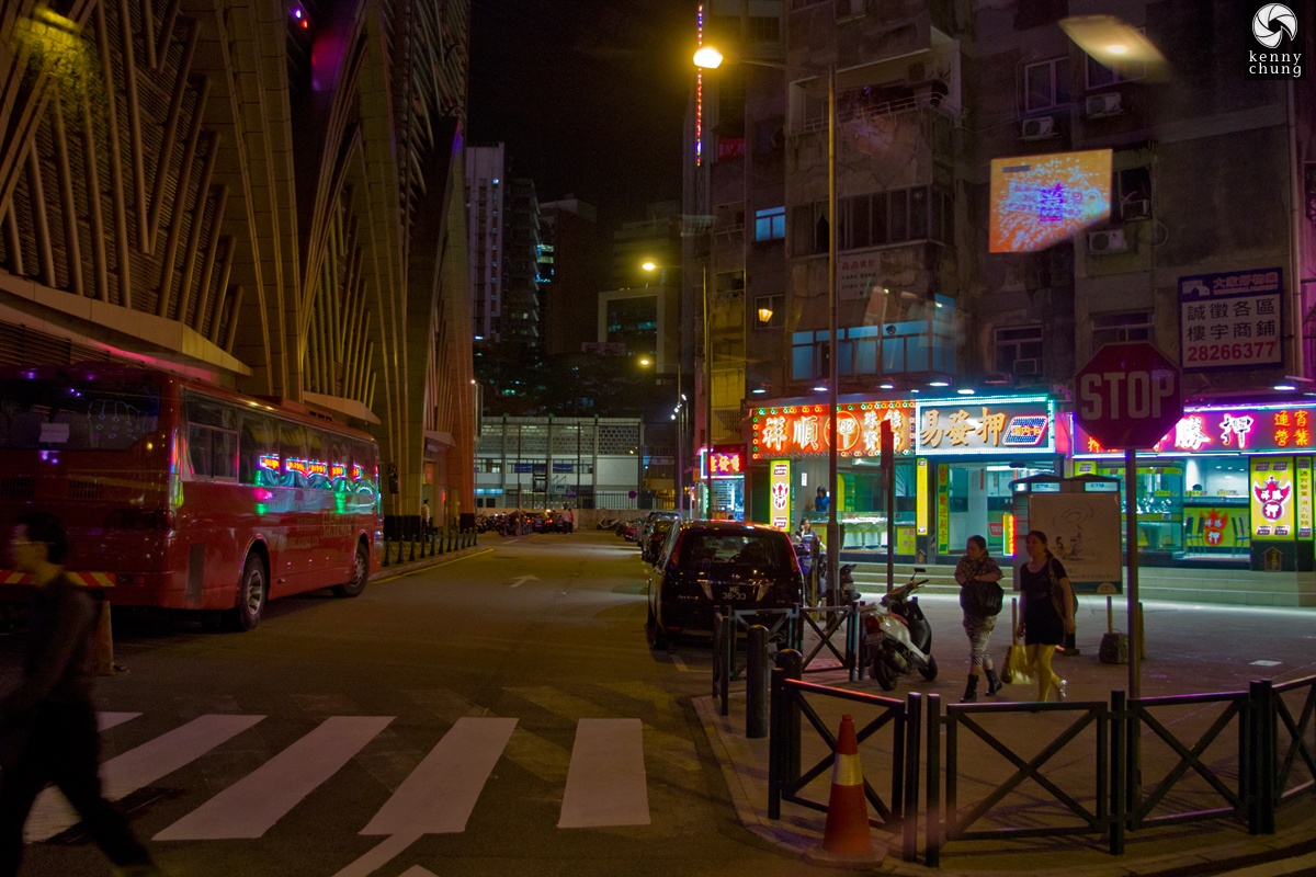 Brightly lit storefronts at night in Macau
