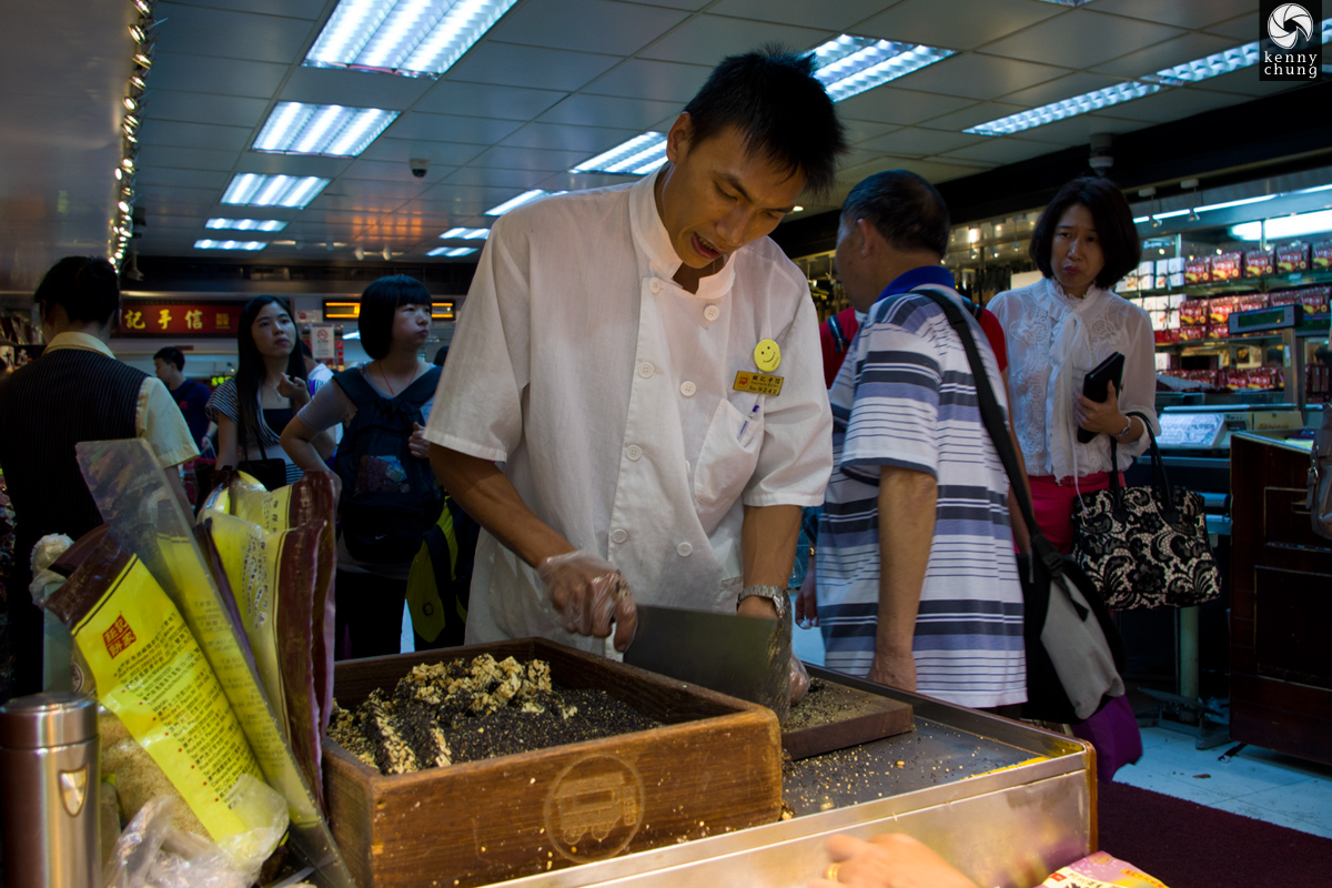 A man making black sesame peanut candies at Pastaleria Koi Kei in Macau