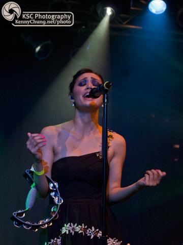 Dia Frampton singing and playing the tambourine at the Highline Ballroom