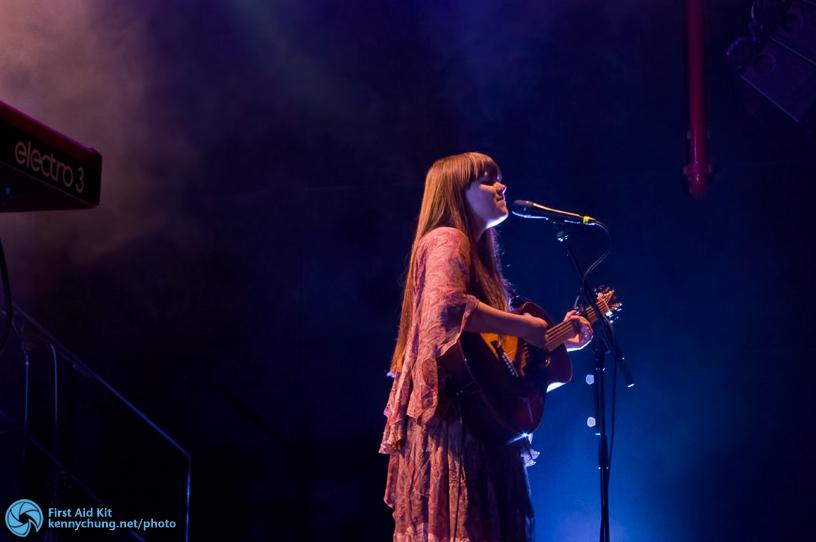 Klara Soderberg singing and playing her acoustic guitar