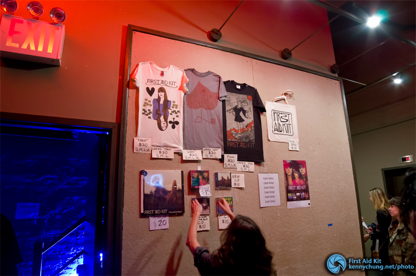 The First Aid Kit merch table with t-shirts and CDs