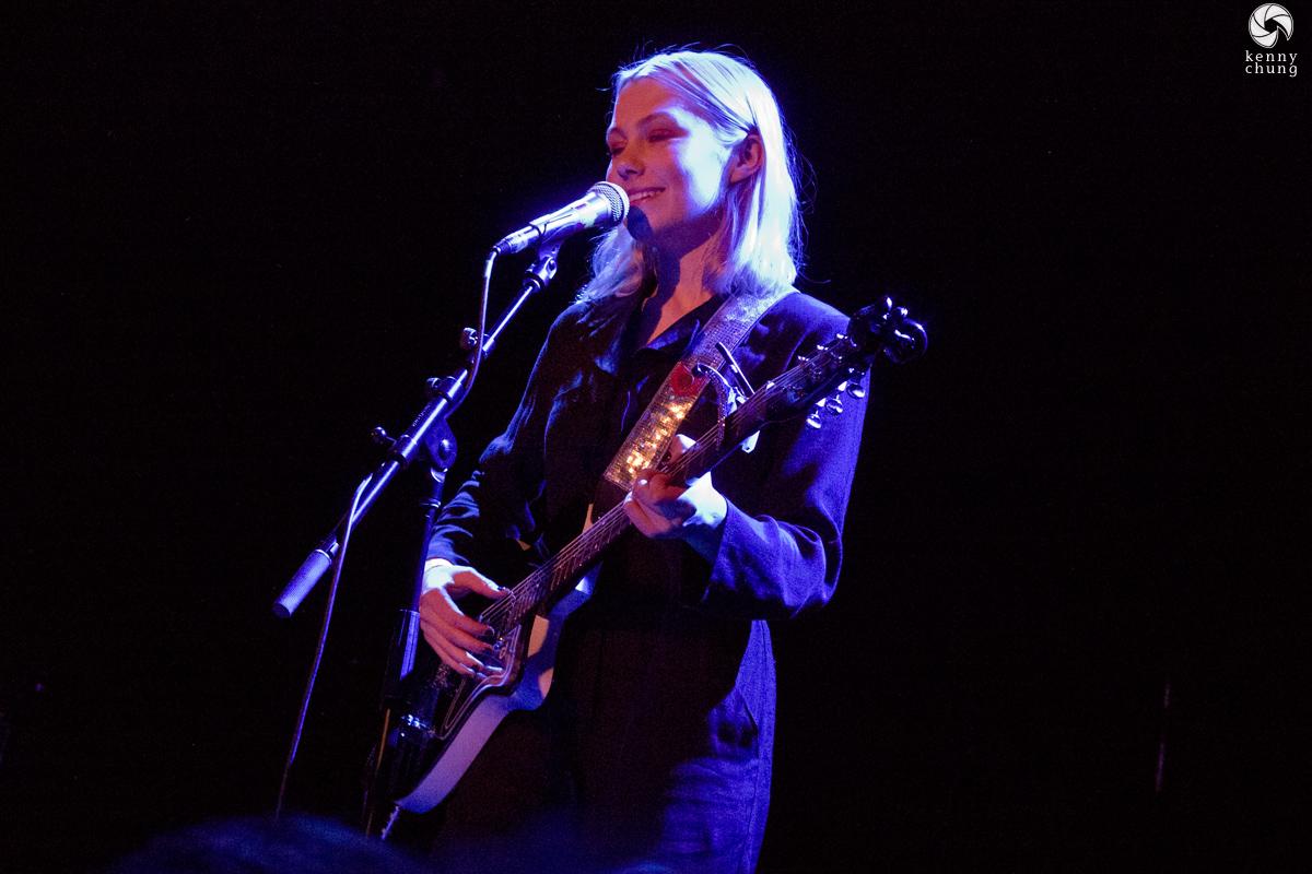 Phoebe Bridgers playing her Danelectro 56 Baritone guitar.