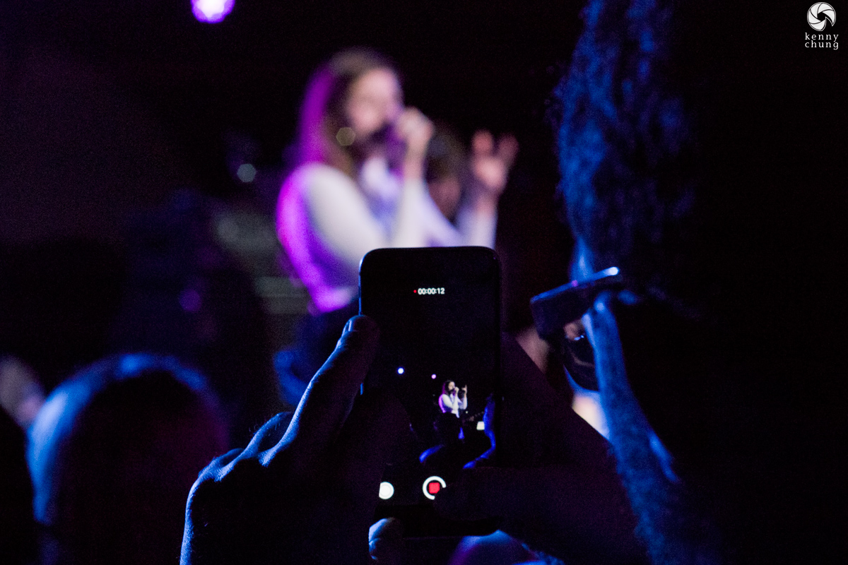 A fan taking a video of LEON performing