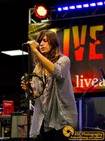Nicole Atkins adjusting her microphone