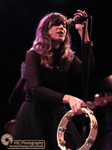 Nicole Atkins playing the tambourine and singing