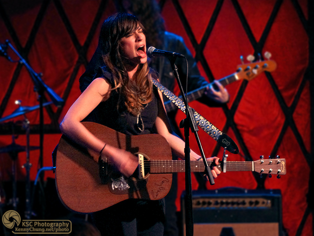 Nicole Atkins singing and playing acoustic guitar at Rockwood Music Hall