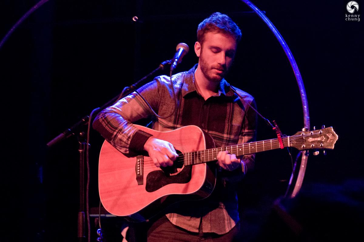 Howard playing guitar at Rough Trade NYC