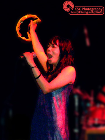 Thao Nguyen singing with a tambourine