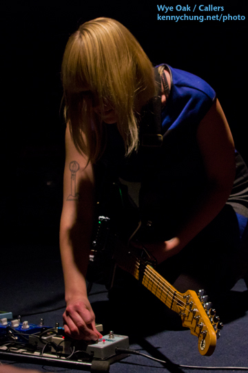 Jenn Wasner adjusting her pedals in between songs.
