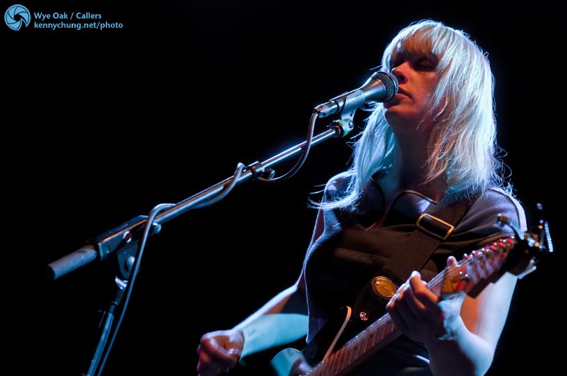 Jenn Wasner singing and playing guitar
