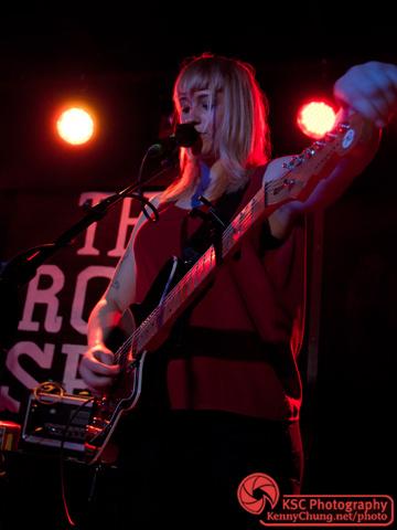 Jenn Wasner tuning her guitar