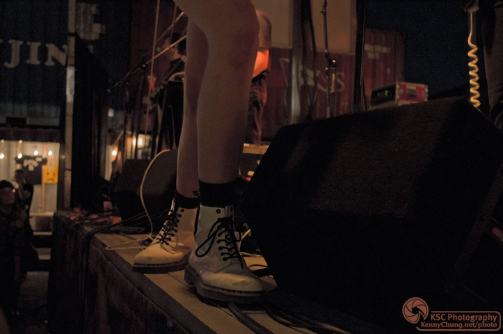 Claire Evan's white high-top sneakers