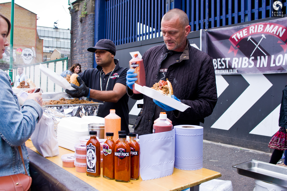 The Rib Man applying Holy Fuck hot sauce at the Brick Lane Market