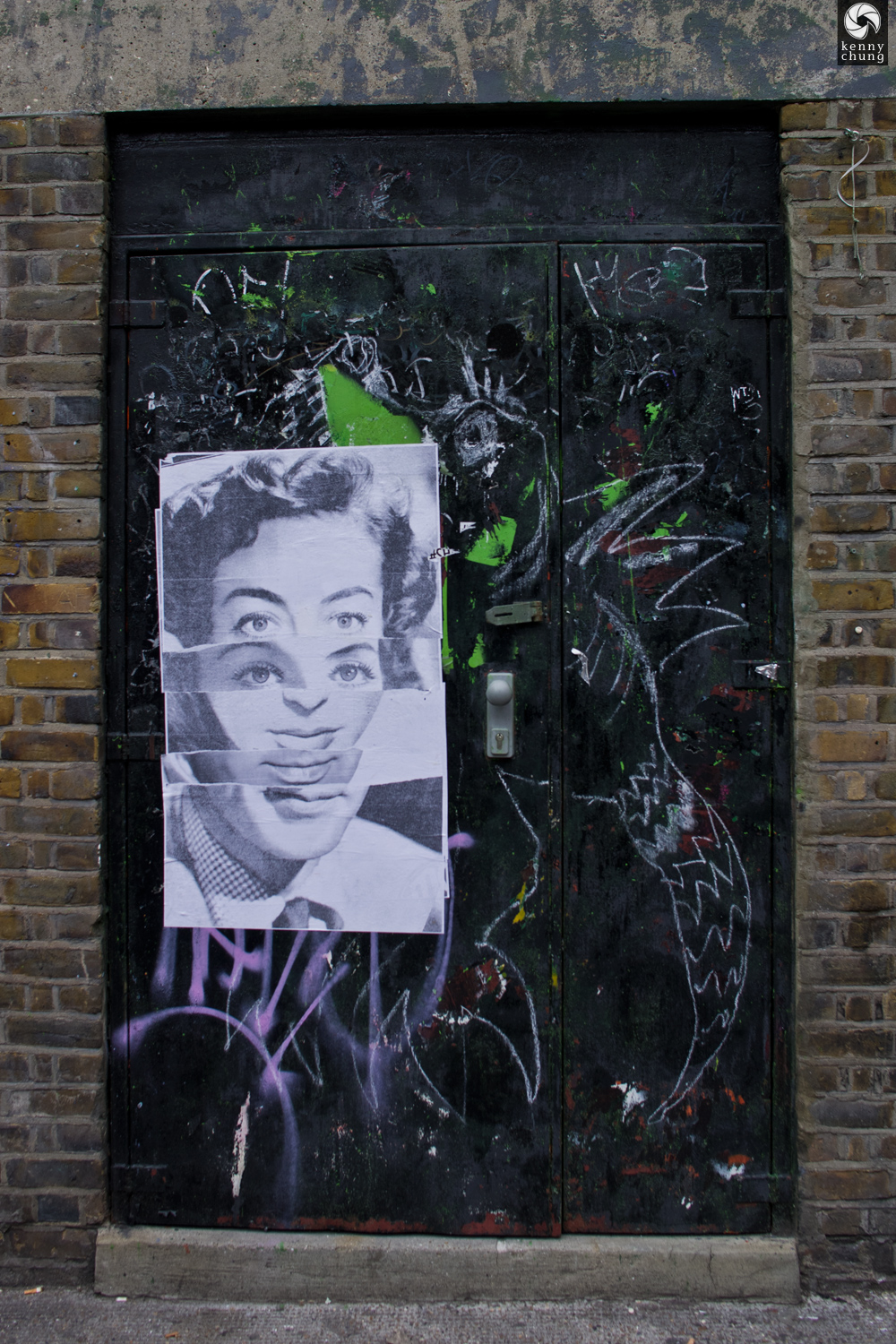 Wheatpaste art on a door in Shoreditch, London
