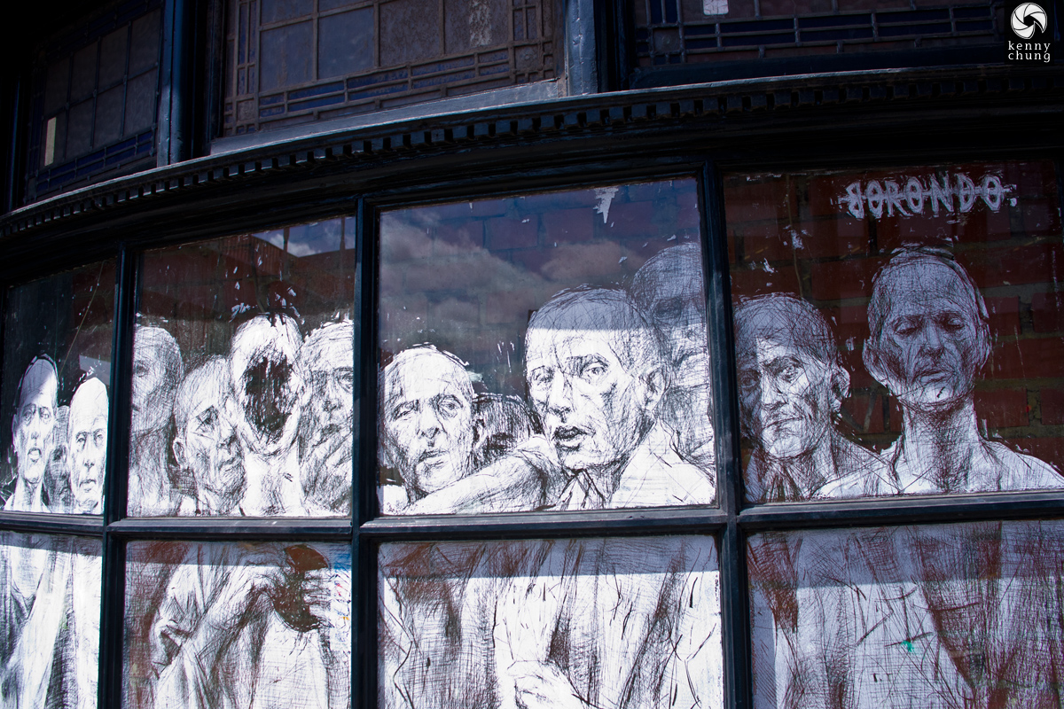 Window glass art by Borondo for Bull in a China Shop in Shoreditch, London
