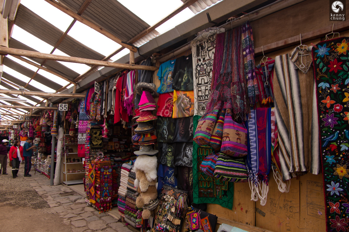 Clothing, hats and bags for sale at Cusco Market in Peru