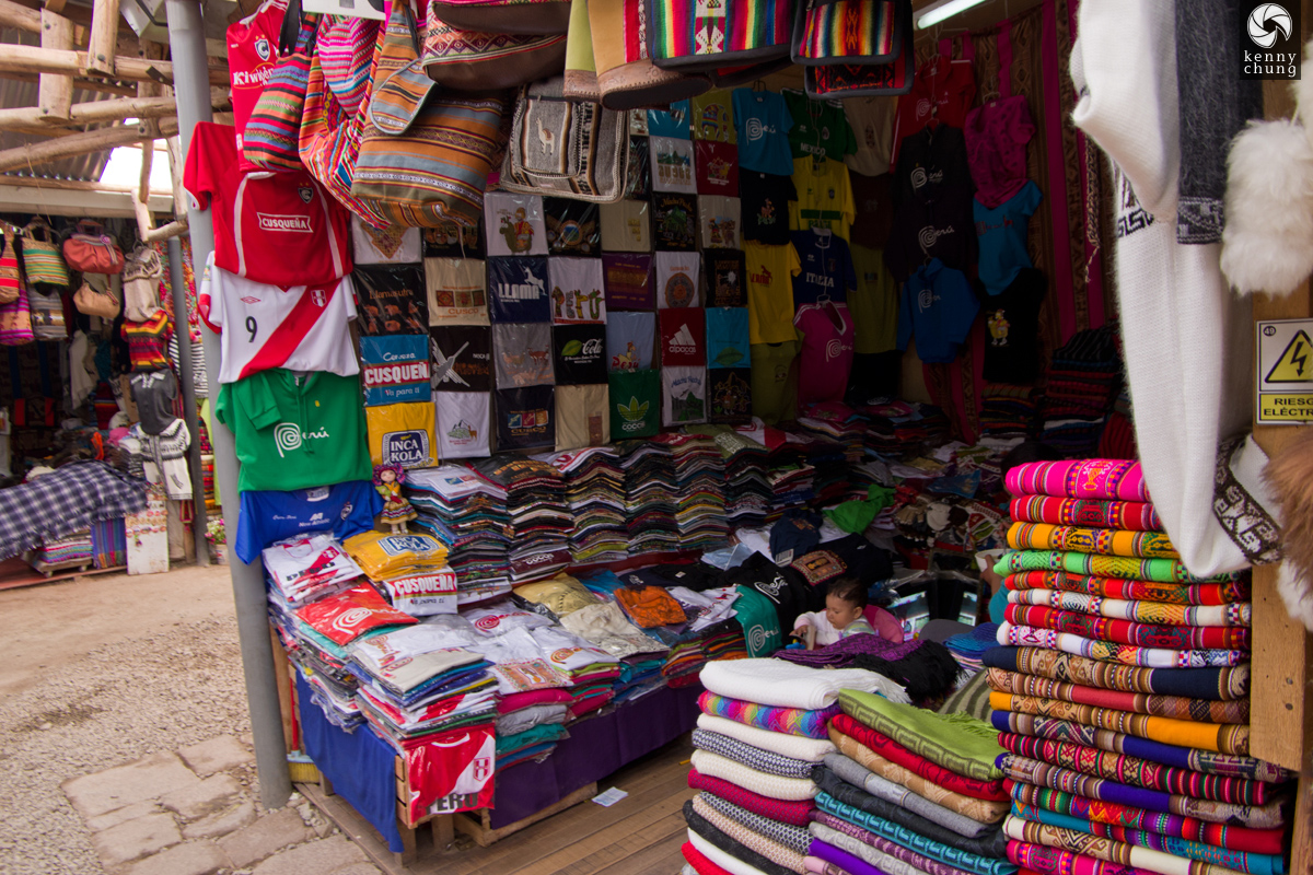 Scarves and t-shirts for sale at Cusco Market in Peru