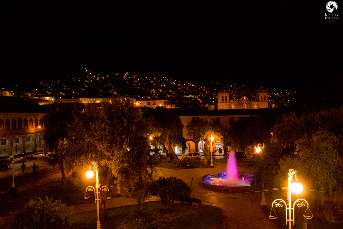 An illuminated fountain in Cusco