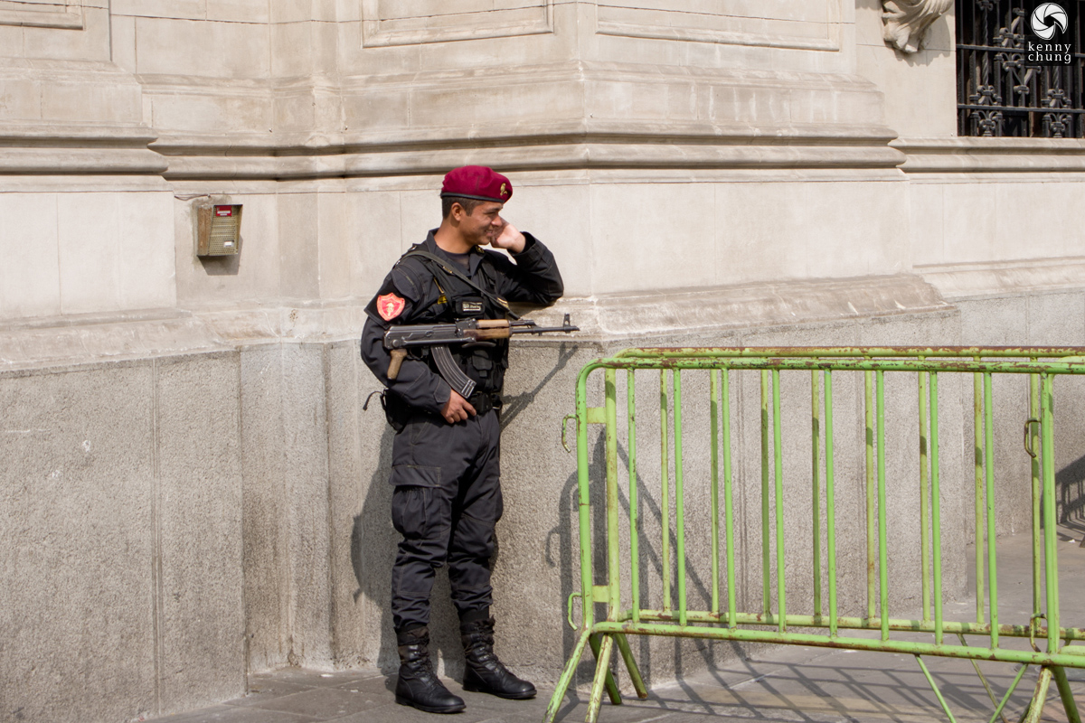 An armed guard outside of Plaza Mayor.