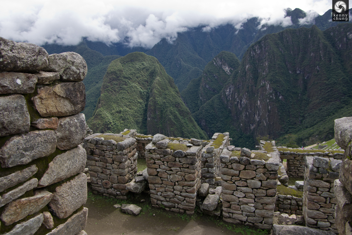Stone walls overlooking the mountains at Machu Picchu