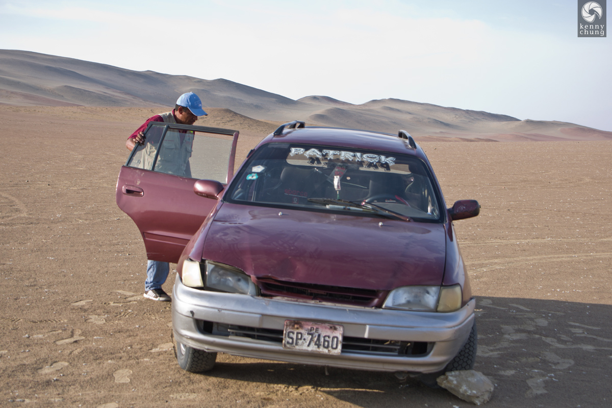 Our tour guide and our car in Paracas