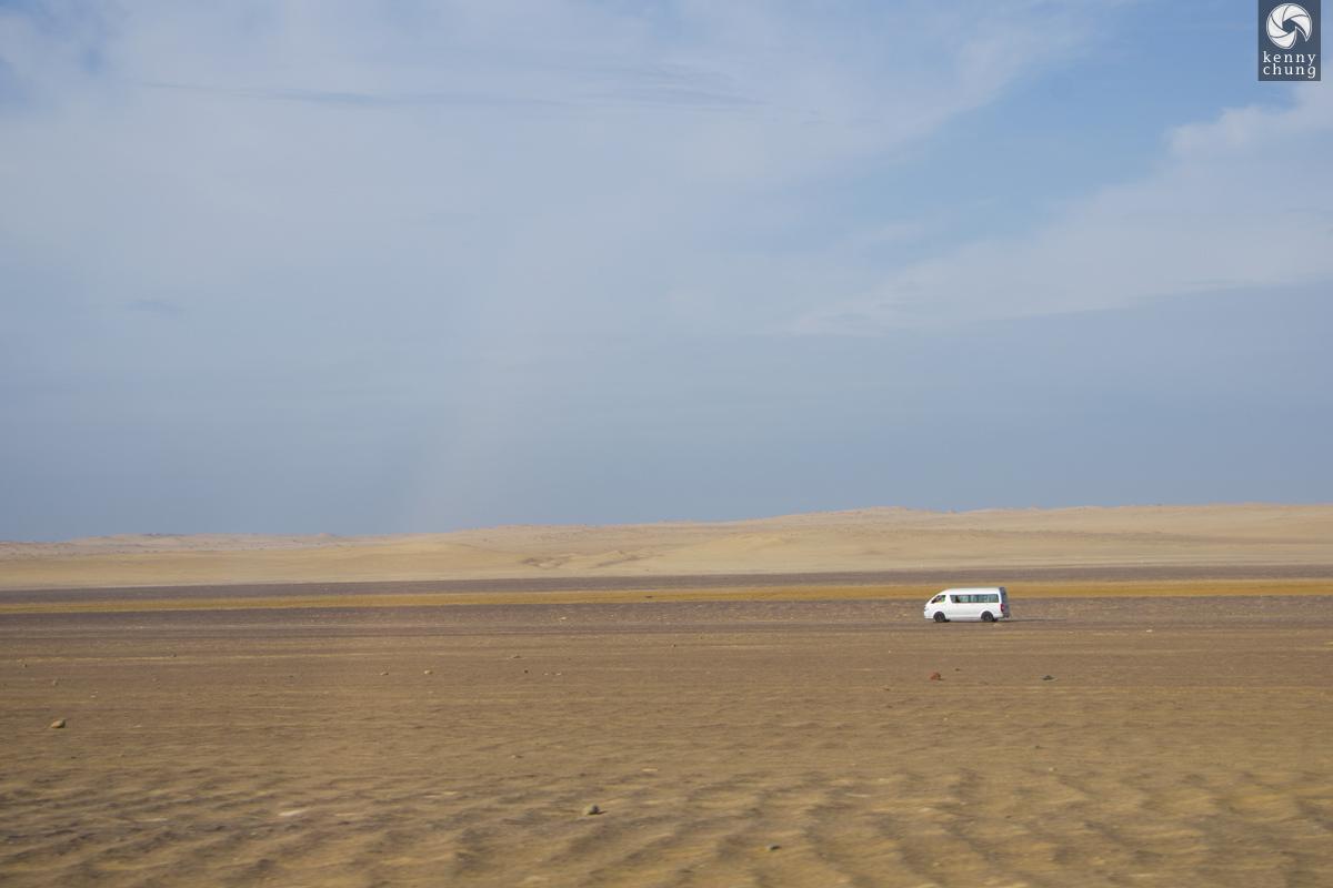 A van in the desert in Paracas