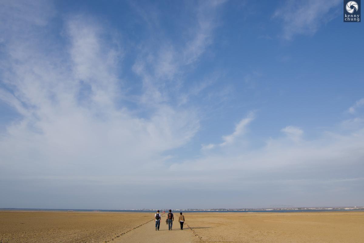 Friends walking the flamingo trail in Paracas
