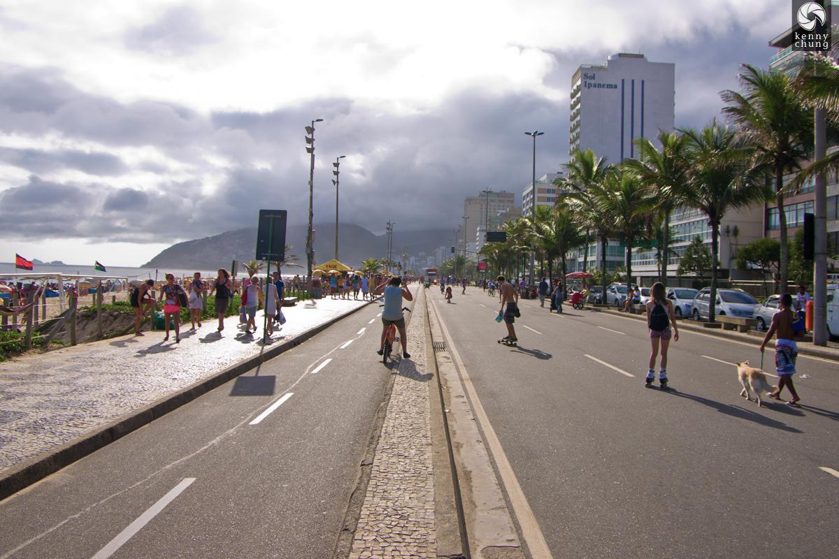 Bikers, skateboarders and dog walkers on Avenida Vieira Souto in Ipanema, Rio de Janeiro