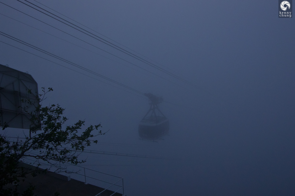 A tram arriving at Sugarloaf Mountain through the fog