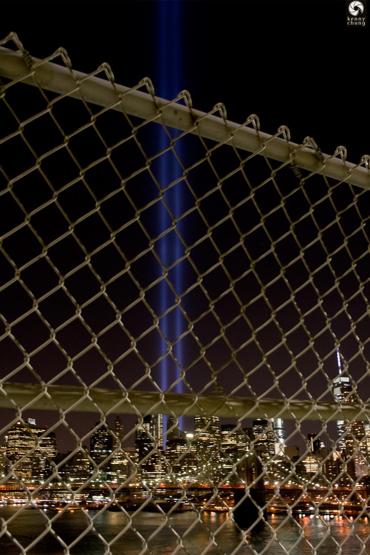 Tribute In Light 2014 through the Manhattan Bridge fence