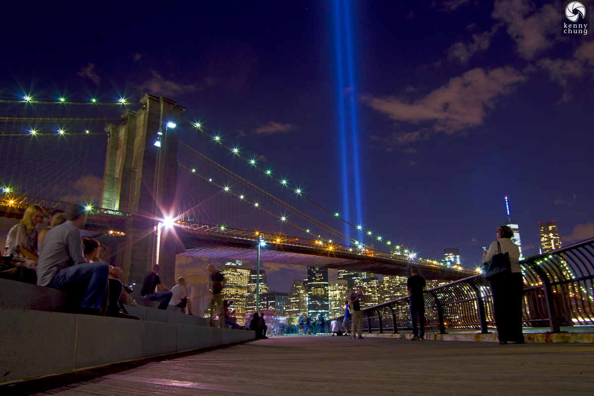 People watching the Tribute In Light 2015 at Brooklyn Bridge Park