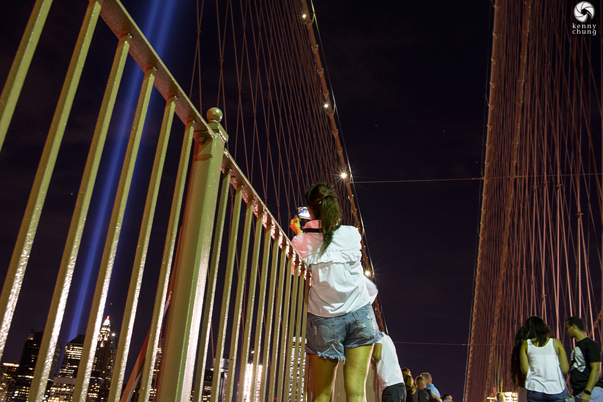 People taking photos of the Tribute in Light 2016 from the Brooklyn Bridge