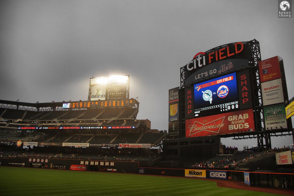 Citi Field scoreboard during a rain delay