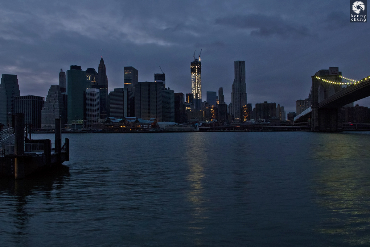 The sun sets on a mostly blacked out Manhattan during Hurricane Sandy