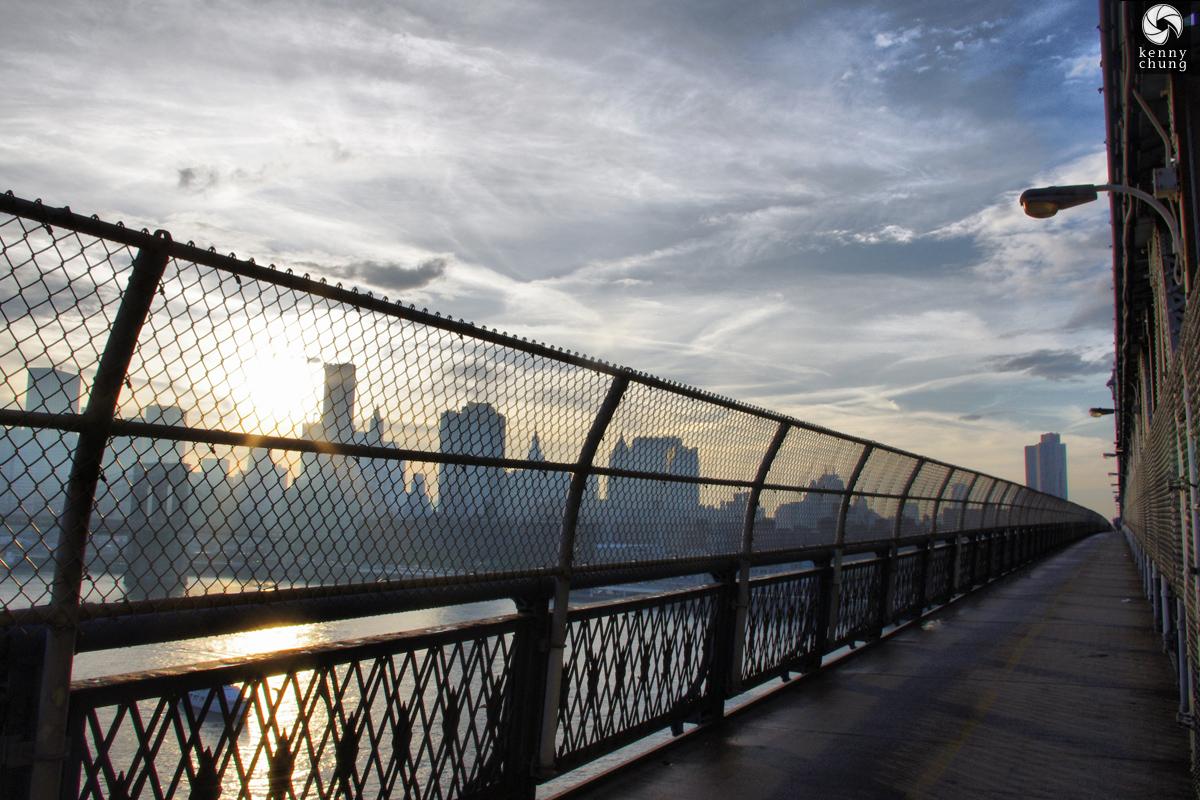 Manhattan Bridge fence and the Brooklyn Bridge