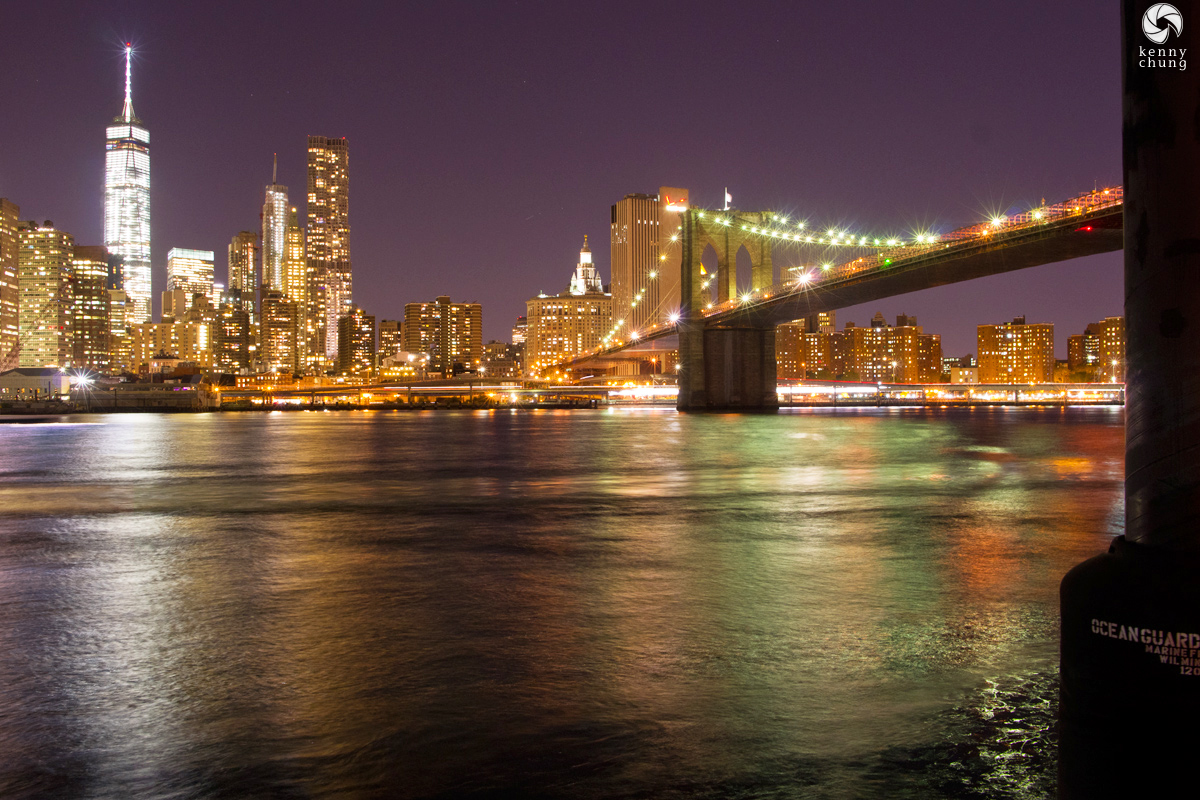 One World Trade and the Brooklyn Bridge at night as photographed from Brooklyn Bridge Park